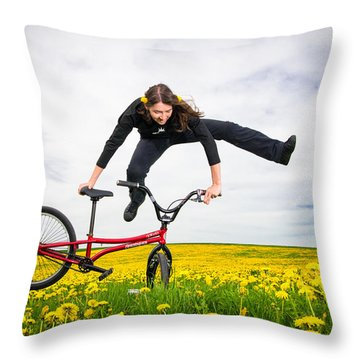 Spring Has Sprung - Bmx Flatland Artist Monika Hinz Jumping In Yellow Flower Meadow Throw Pillow by Matthias Hauser