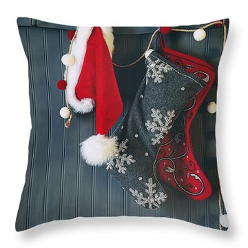 Throw Pillow featuring the photograph Stockings Hanging On Hooks For The Holidays by Sandra Cunningham