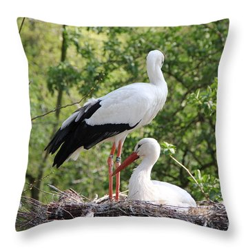 Storks Nesting Throw Pillow