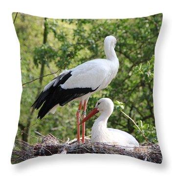 Storks Nesting Throw Pillow