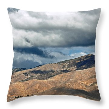 Storm Clouds Floating Above Mountains Throw Pillow by Susan Wiedmann
