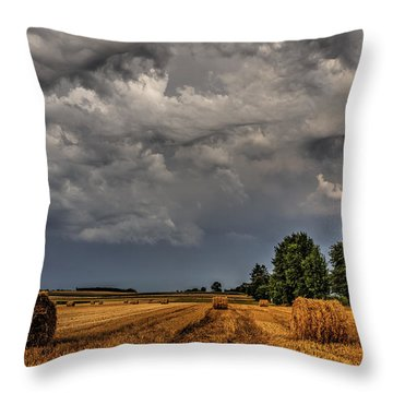 Storm Clouds Over Harvested Field In Poland 2 Throw Pillow