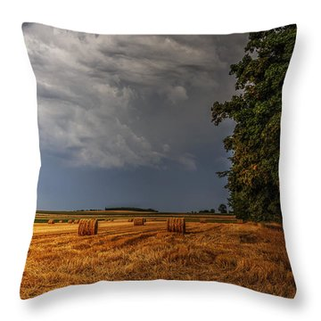 Storm Clouds Over Harvested Field In Poland Throw Pillow