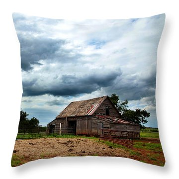 Storms Loom Over Barn On The Prairie Throw Pillow