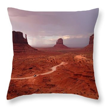 Storms Moving Through Monument Valley Throw Pillow