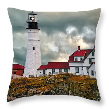 Stormy Portland Head Light Throw Pillow by Nick Zelinsky