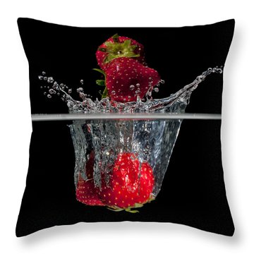 Strawberries Splashing In Water Throw Pillow by Mike Santis