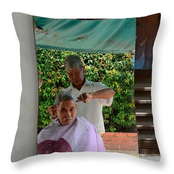 Street Side Barber Cuts Client Hair Singapore Throw Pillow by Imran Ahmed