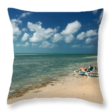 Sunbathers On The Beach Throw Pillow by Amy Cicconi