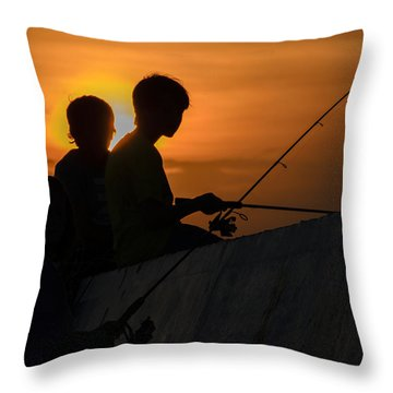Sunset Anglers Throw Pillow by Keith Armstrong