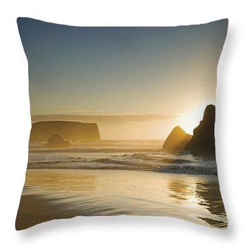 Sunset Behind Offshore Rocks Bandon Throw Pillow by Philippe Widling