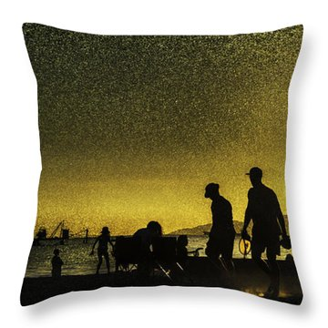 Throw Pillow featuring the photograph Sunset Silhouette Of People At The Beach by Peter v Quenter