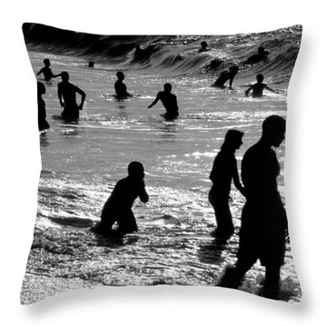 Surf Swimmers Throw Pillow by Sean Davey