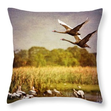 Swans In Flight Throw Pillow