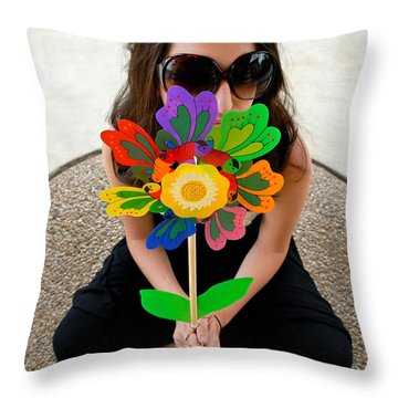Teenage Girl Hiding Behind Toy Flower Throw Pillow by Amy Cicconi