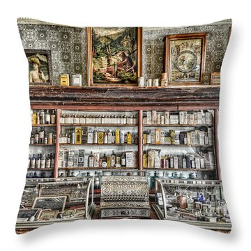 The Drug Store Counter Throw Pillow by Ken Smith