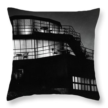 The Exterior Of A Spiral House Design At Night Throw Pillow