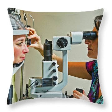The Eye Doctor Throw Pillow by Keith Armstrong