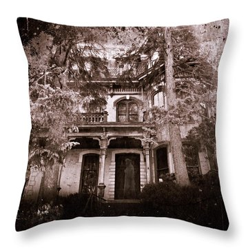 The Haunting Throw Pillow