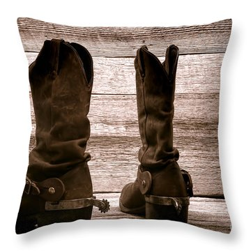 The Lost Boots Throw Pillow by Olivier Le Queinec