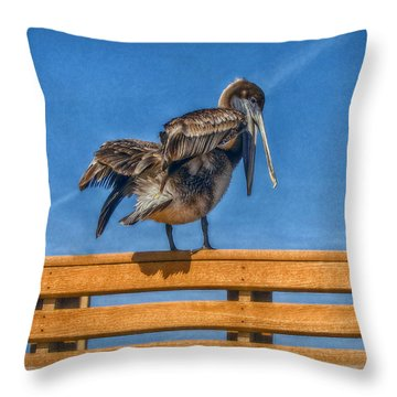 Throw Pillow featuring the photograph The Pelican by Hanny Heim
