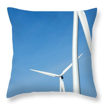 Three Mighty Windmills In A Row Against A Blue Sky. Throw Pillow