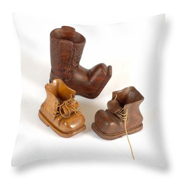 Three Small Boots Carvings Throw Pillow by Michael Flood