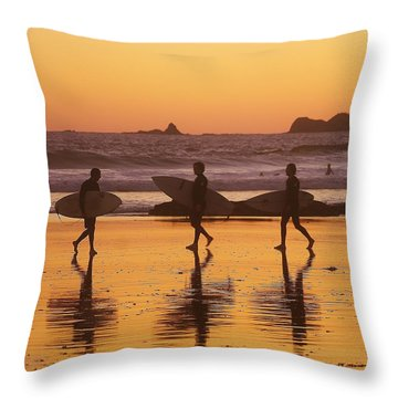 Three Surfers At Sunset Throw Pillow by Blair Stuart