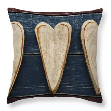 Three Wooden Hearts Throw Pillow by Carol Leigh