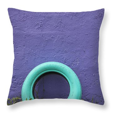 Throw Pillow featuring the photograph Tire Painted In Bright Color Leaning Against Wall In San Juan Pue by Bryan Mullennix