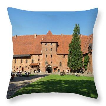Tourists At Malbork Castle, Malbork Throw Pillow