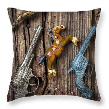 Toy Guns And Horses Throw Pillow by Garry Gay