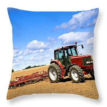 Tractor In Plowed Farm Field Throw Pillow