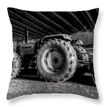 Throw Pillow featuring the photograph Tractor In The Barn by Joseph Amaral