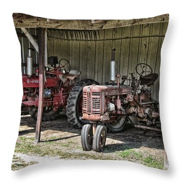 Tractors In The Shed Throw Pillow by Victor Montgomery