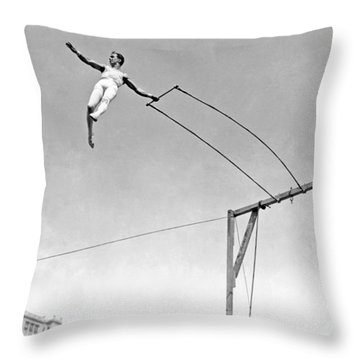 Trapeze Artist On The Swing Throw Pillow by Underwood Archives