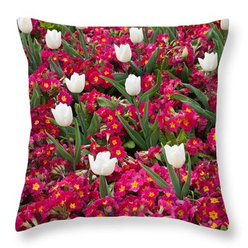 Tulips And Primroses Throw Pillow by Geraldine Alexander