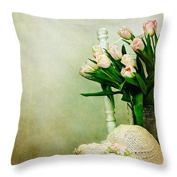 Tulips On A Chair Throw Pillow by Stephanie Frey