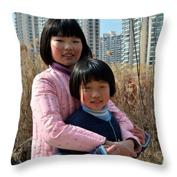 Two Chinese Teen Sisters Hug  And Embrace Shanghai China Throw Pillow by Imran Ahmed