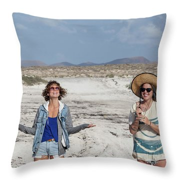 Two Girls Having Fun In The Middle Throw Pillow