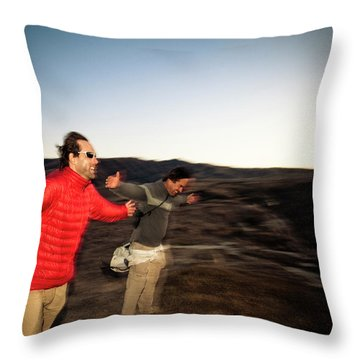 Two Men Stretch Out Their Arms And Lean Throw Pillow