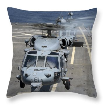 Two Mh-60s Sea Hawk Helicopters Take Throw Pillow by Stocktrek Images