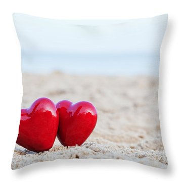 Two Red Hearts On The Beach Symbolizing Love Throw Pillow by Michal Bednarek