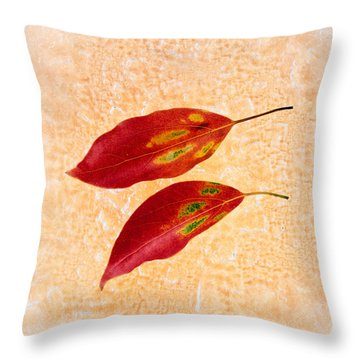 Two Red Leaves On Pink Background Throw Pillow