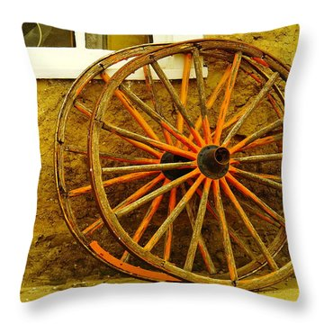 Two Wagon Wheels Throw Pillow by Jeff Swan