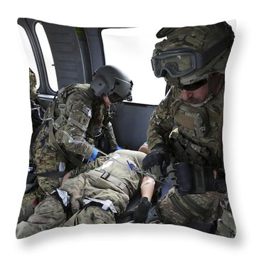 U.s. Army Flight Medics Aid A Simulated Throw Pillow by Stocktrek Images