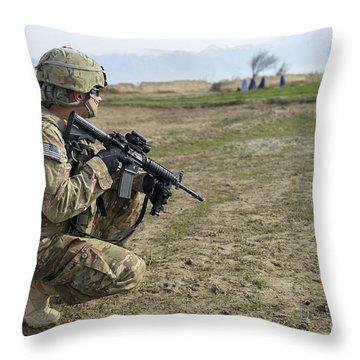 U.s. Soldier Patrols A Village Throw Pillow by Stocktrek Images