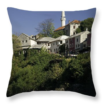 view of Mostar in Bosnia Hercegovina with minaret bridge and river Throw Pillow
