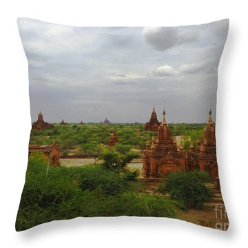 Throw Pillow featuring the photograph View Of Smaller Temples Next To Dhammayazika Pagoda Built In 1196 By King Narapatisithu Bagan Burma by Ralph A  Ledergerber-Photography