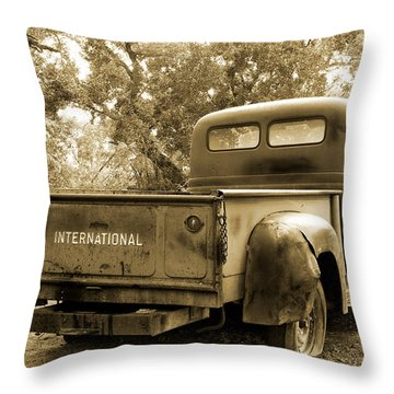 Throw Pillow featuring the photograph Vintage International by Steven Bateson